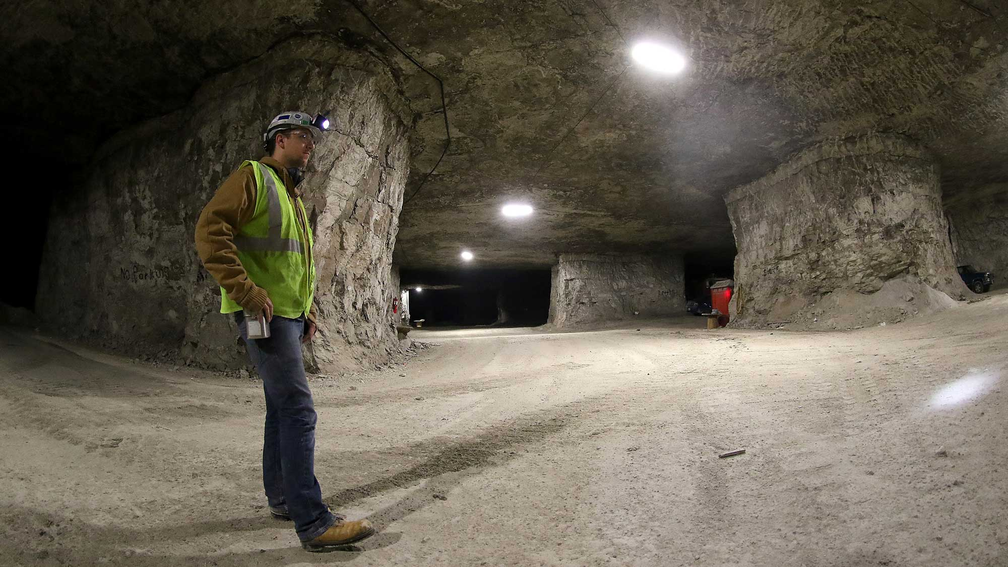 Foreman viewing the underground limestone mine within a large cavern