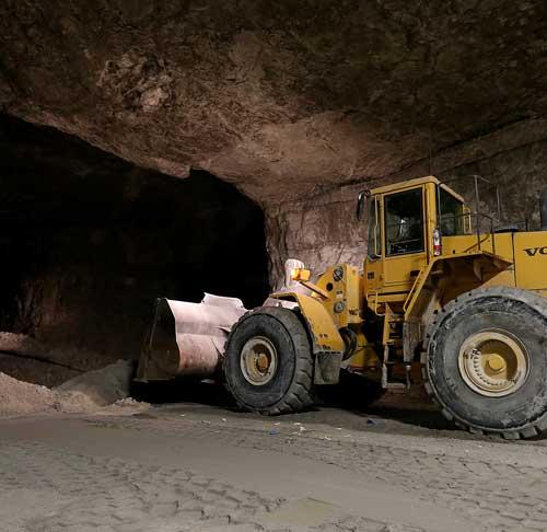 Dozer moving limestone blasted in the underground mine at Linwood Mining