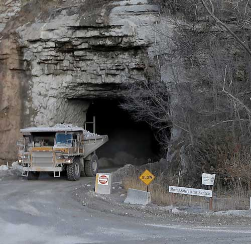 Large load of limestone in a heavy dump truck exiting the underground mine at Linwood Mining