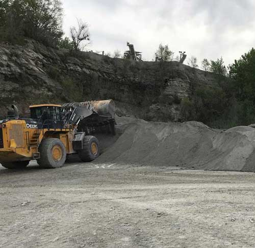 Heavy equipment moving limestone at Linwood Mining