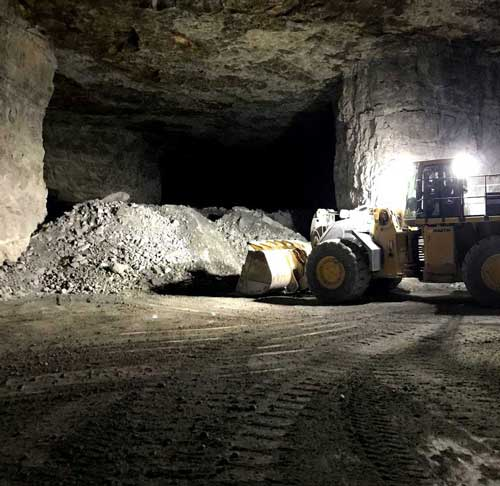 Heavy equipment moving lime blasted in the underground mine at Linwood Mining